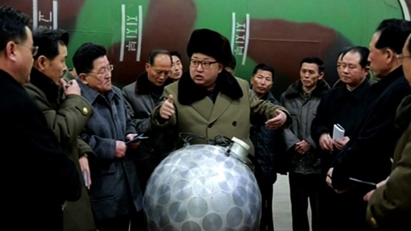 """This undated picture released from North Korea's official Korean Central News Agency (KCNA) on March 9, 2016, shows North Korean leader Kim Jong Un in front of a device analysts have dubbed the """"disco ball."""""""