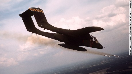 FILE PHOTO: A 21st Tactical Air Support Squadron OV-10 Bronco aircraft fires white phosphorus rockets to mark a target for an air strike during tactical air control training. (Photo by USAF)