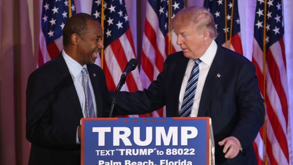 Republican presidential candidate Donald Trump stands with former presidential candidate Ben Carson as he receives his endorsement at the Mar-A-Lago Club on March 11, 2016 in Palm Beach, Florida. Presidential candidates continue to campaign before Florida