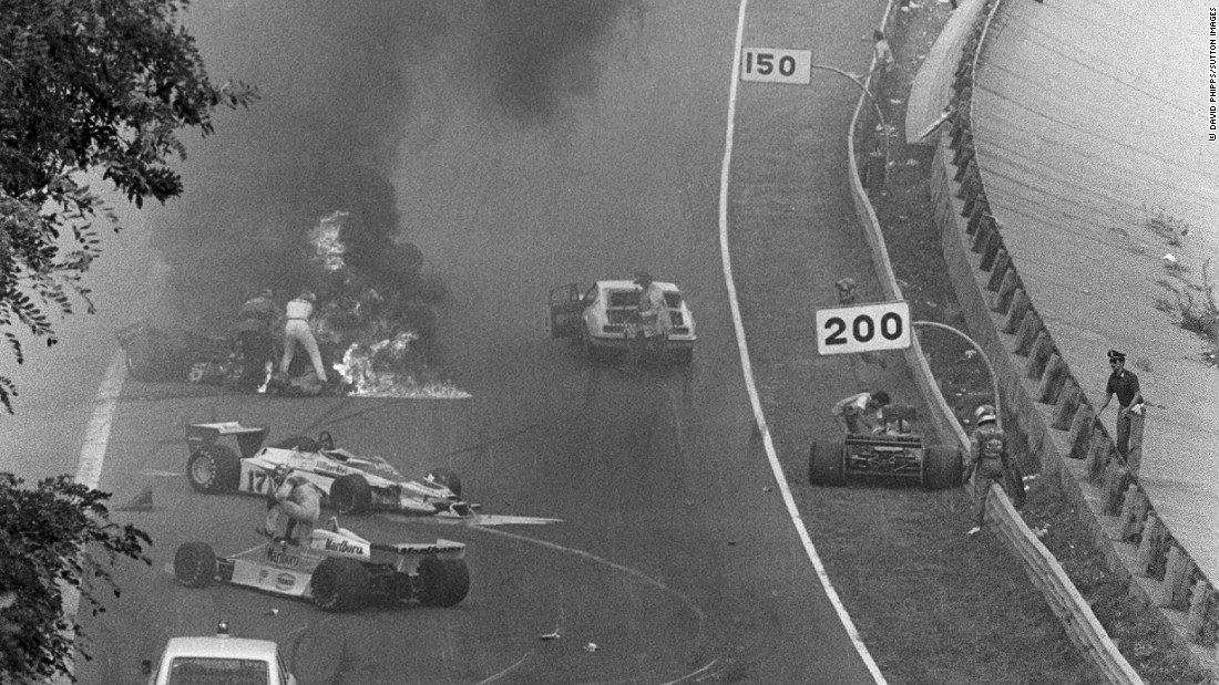 British photographer David Phipps captures the moments of panic and subsequent tragedy as Hunt attempts to pull Swedish driver Ronnie Peterson out from his burning Lotus car at the 1978 Italian Grand Prix. Peterson later died in hospital from a blood clot following an operation on his badly-broken legs.
