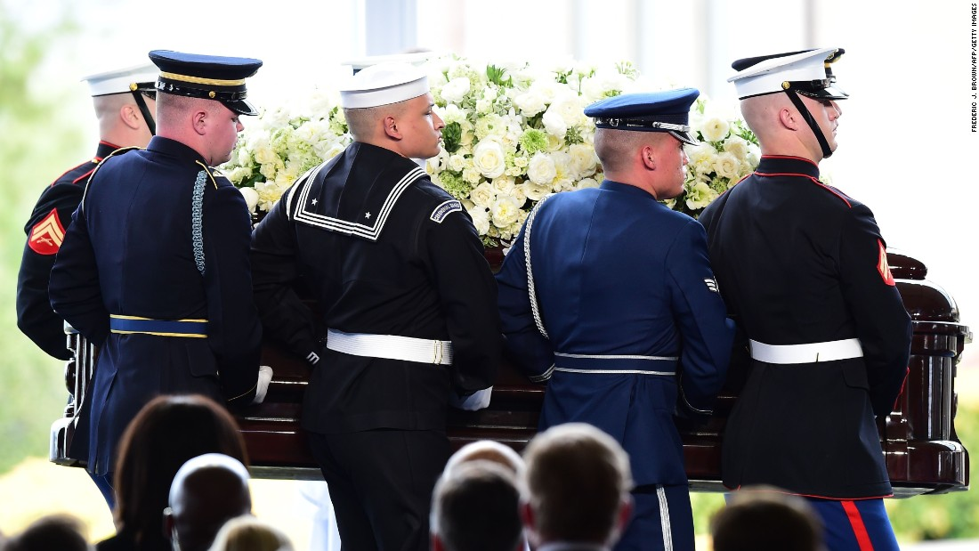 The casket of former first lady Nancy Reagan is carried to her funeral.