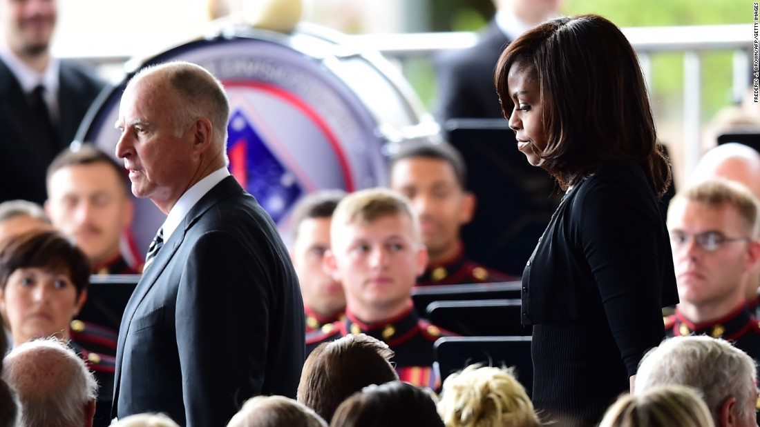 California Gov. Jerry Brown and U.S. first lady Michelle Obama arrive for the service.