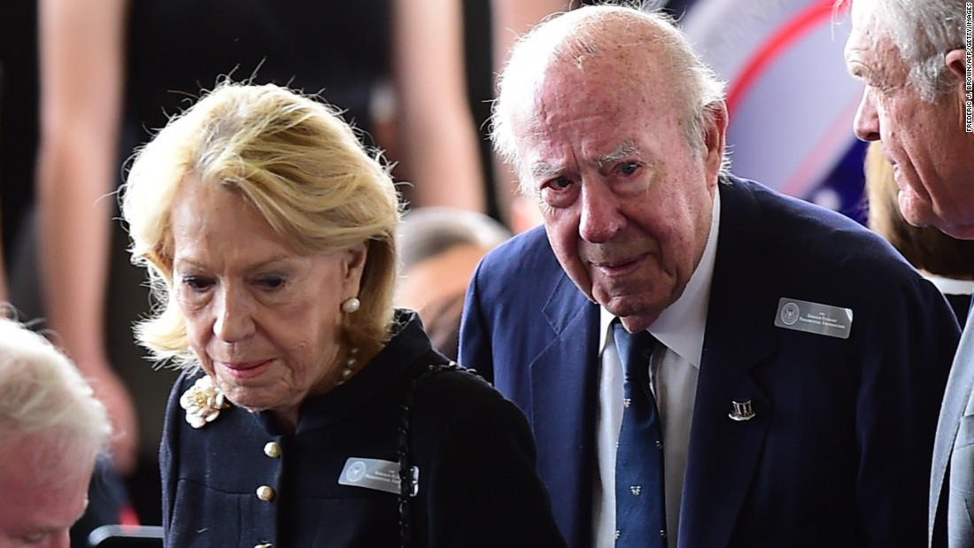 Former U.S. Secretary of State George Shultz and his wife, Charlotte Mailliard Shultz, arrive for the funeral.