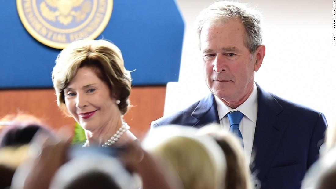 Former President George W. Bush and his wife, Laura, arrive.