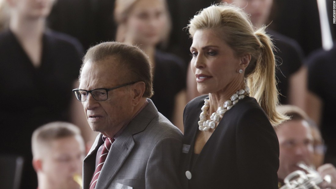 Journalist Larry King and his wife, Shawn, arrive.