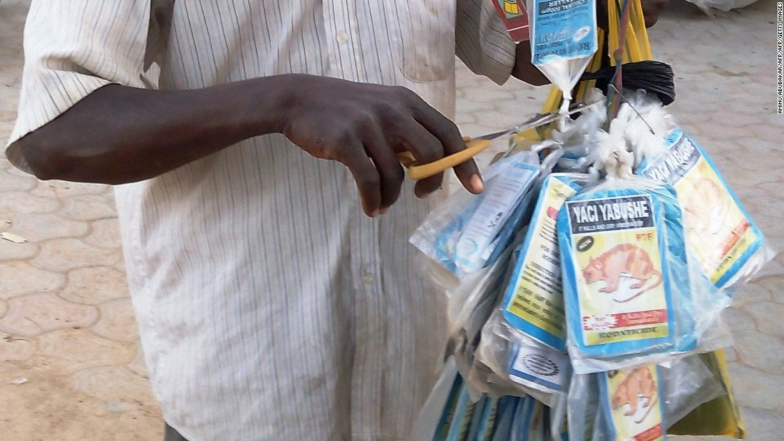 Sales of rat poison, as a means of preventing infection, have taken off in Nigeria following the outbreak of Lassa fever. Pictured, a vendor sells bags of rat poison in northern Nigeria's largest city of Kano.