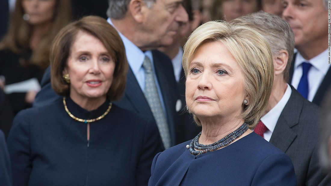 Former Secretary of State Hillary Clinton and  Rep. Nancy Pelosi wait to pay their respects.