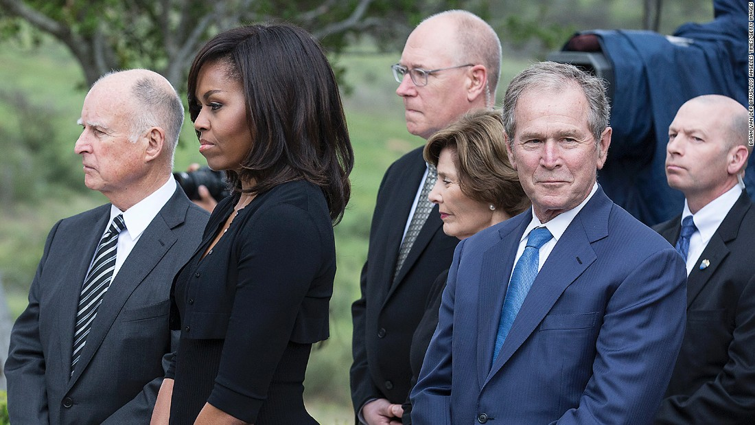 California Gov. Jerry Brown, left, first lady Michelle Obama, former first lady Laura Bush and former president George W. Bush, right, attend the graveside service.