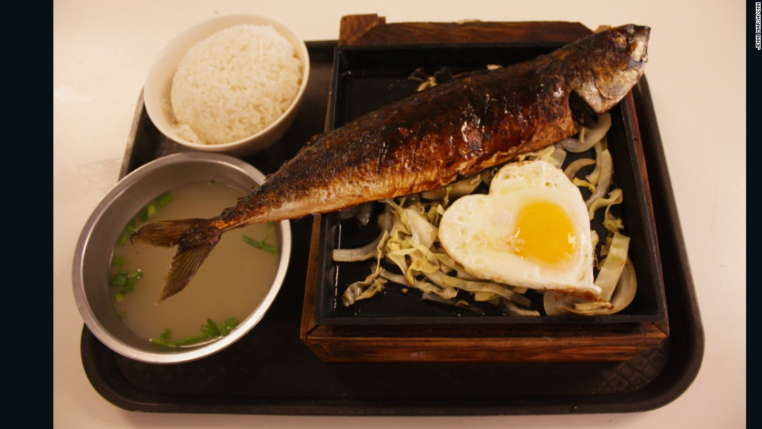 "Taiwanese ""hot pot"" mackerel is sold with the fried egg cut into a cute heart shape."