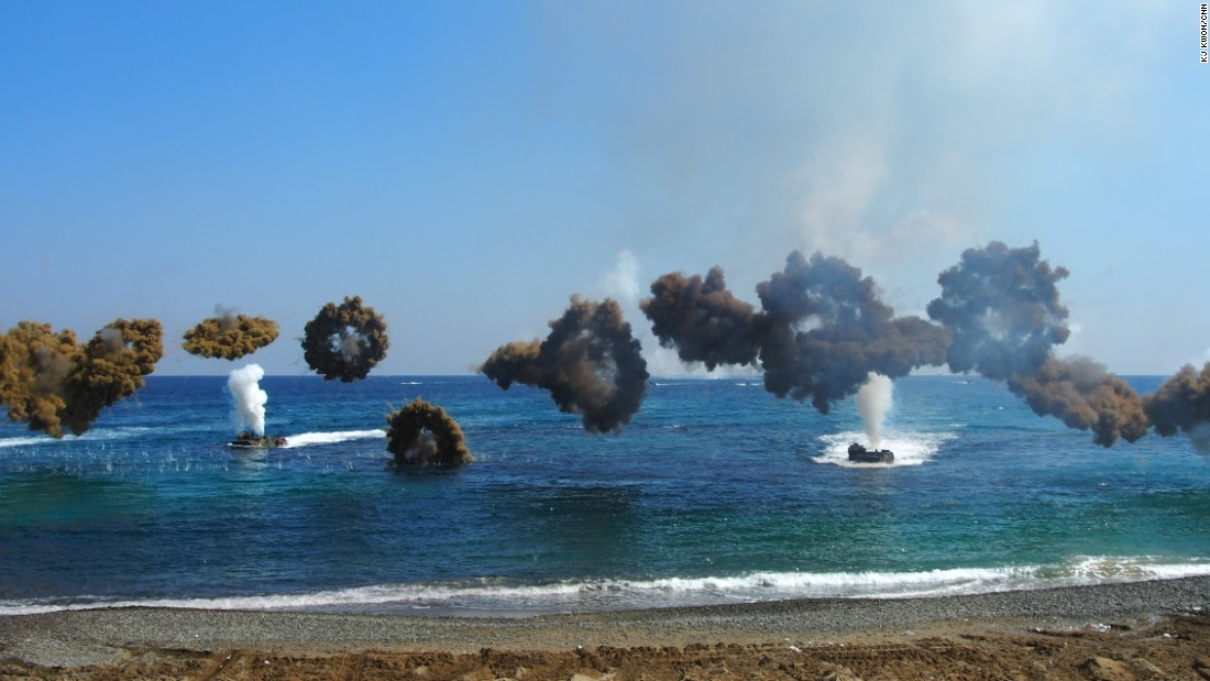 "Clouds of camouflage smoke obscure amphibious assault vehicles coming into shore as part of military exercises on March 12.  South Korea's defense ministry spokesman is calling the maneuvers ""the largest scale ever,"" involving 300,000 South Korean soldiers and at least 17,000 from the U.S."