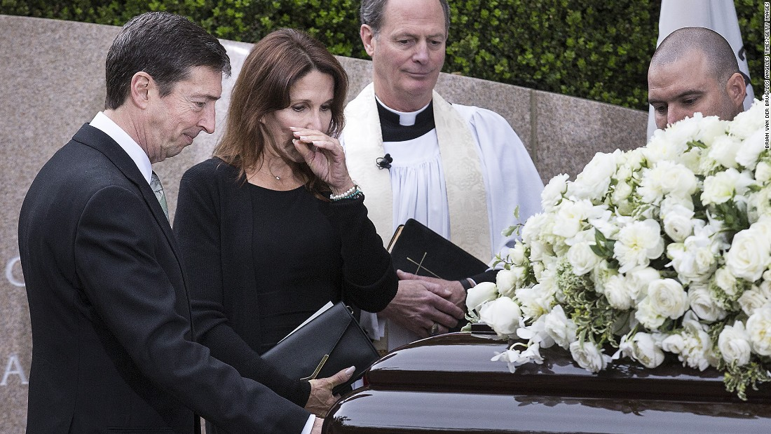 "Ron Reagan and sister Patti Davis pause at the casket of their mother, Nancy Reagan, at her gravesite at the Ronald Reagan Presidential Library in Simi Valley, California, on Friday, March 11. <a href=""http://www.cnn.com/2016/03/11/politics/gallery/nancy-reagan-funeral/index.html"" target=""_blank"">Funeral services for the former first lady </a>were held at the library Friday."