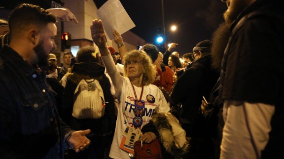 Donald Trump supporter Birgitt Peterson of Yorkville, Illinois, argues with protesters outside the UIC Pavilion after the canceled rally for the Republican presidential candidate in Chicago on Friday, March 11. Peterson told the Chicago Tribune that she responded with the Nazi-style salute after anti-Trump protestors called her a Nazi. The Trump rally was canceled because of concerns after hundreds of protestors packed into the University of Illinois at Chicago venue.
