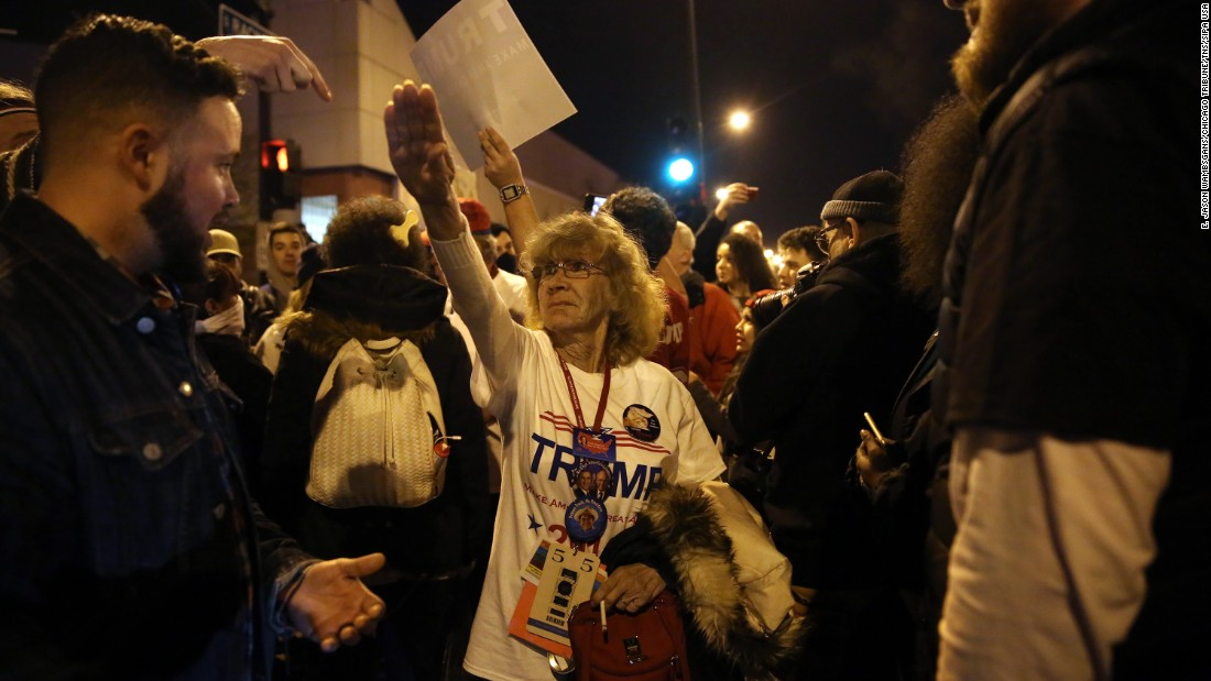 "Donald Trump supporter Birgitt Peterson of Yorkville, Illinois, argues with protesters outside the UIC Pavilion after the canceled rally for the Republican presidential candidate in Chicago on Friday, March 11. <a href=""http://www.chicagotribune.com/news/ct-birgitt-peterson-trump-rally-met-0313-20160312-story.html"" target=""_blank"">Peterson told the Chicago Tribune</a> that she responded with the Nazi-style salute after anti-Trump protestors called her a Nazi. <a href=""http://www.cnn.com/2016/03/12/politics/donald-trump-protests/index.html"" target=""_blank"">The Trump rally was canceled</a> because of concerns after hundreds of protestors packed into the University of Illinois at Chicago venue."