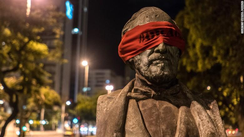 Brazil protests: Artist blindfolds statues amid corruption scandal - CNN
