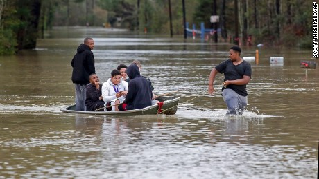 Zavion Watson pulls a boat full of relatives to dry land on March 11 as they evacuate their homes in Independence, Louisiana. Heavy rain has brought flooding that damaged thousands of homes.