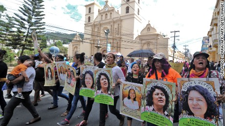 Protesters hold pictures of Caceres at an International Women's Day demo in Tegucigalpa on March 8.