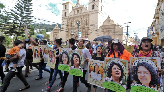 Protesters hold pictures of Berta Caceres at an International Women's day demonstration in Tegucigalpa on March 8.