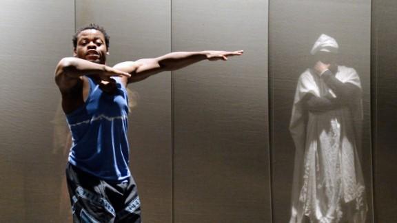 Nigerian dancer and choreographer Qudus Onikeku (left) and Cameroonian actor Emil Abossolo perform a scene of Onikeku
