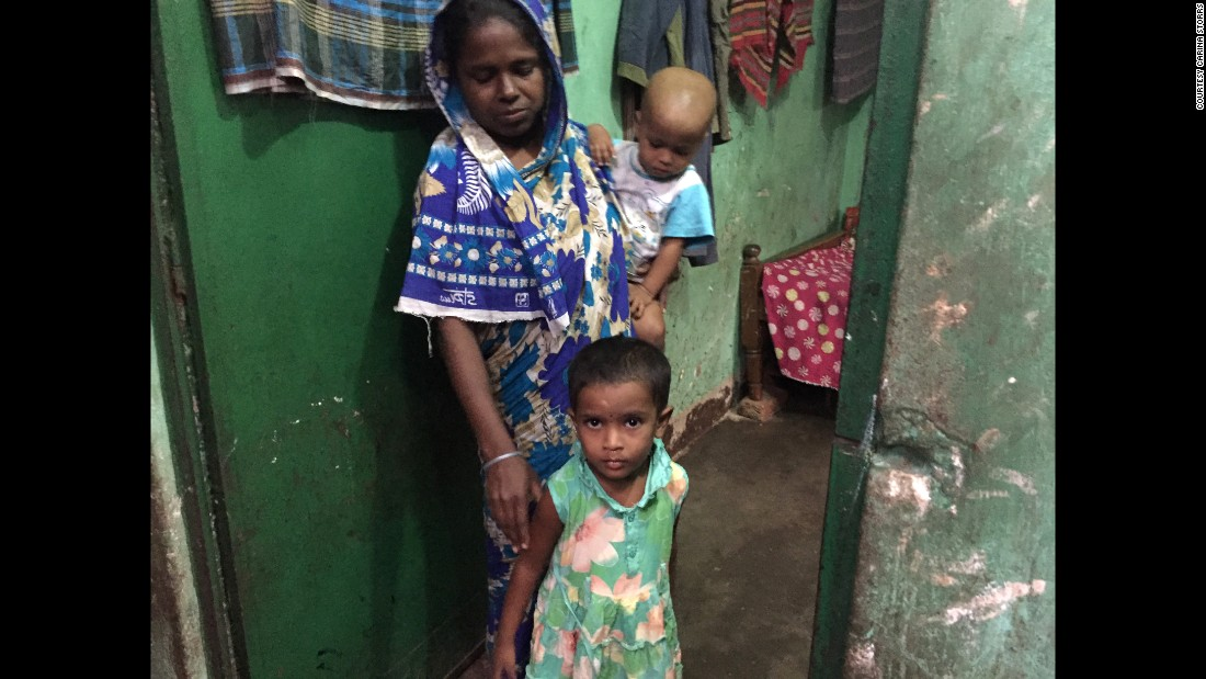 Munni, center, takes a break from playing outside to greet a group of researchers visiting her mother, Banu. Researchers have been stopping by the family's home for years to find out if Munni, who received the rotavirus vaccine as a baby, has been ill.