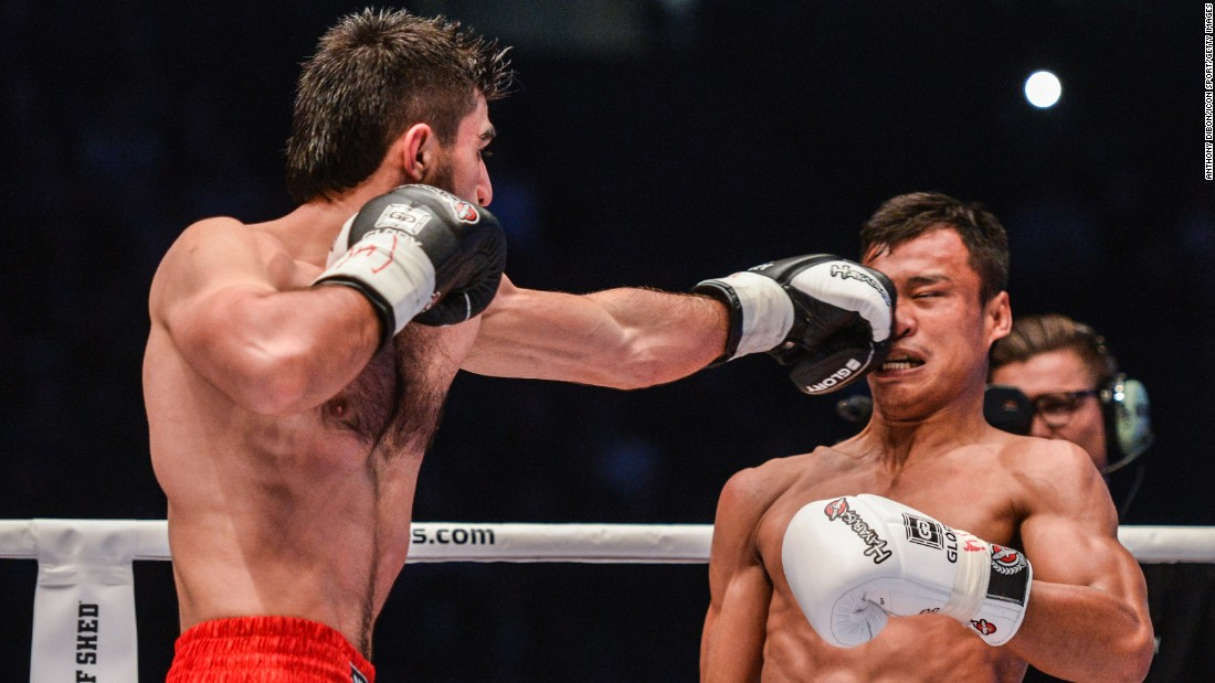 Marat Grigorian, left, punches Sitsongpeenong during the Kickboxing World Championship on Saturday, March 12, in Paris.