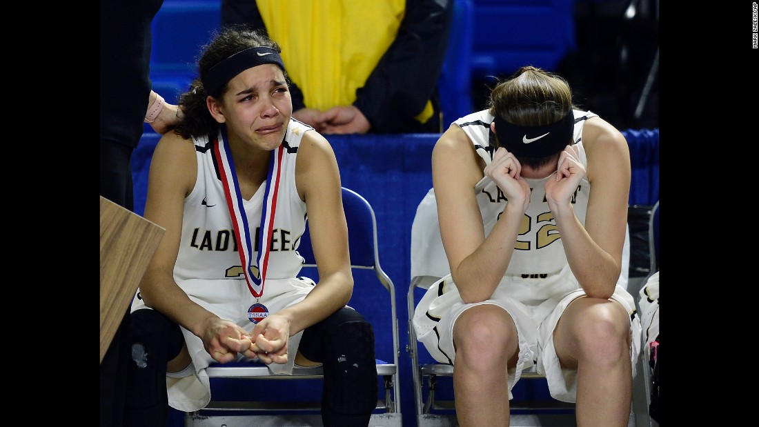 Upperman's Akira Levy, left, and Ashlyn Medley, right, cry after their loss against East Nashville in the Tennessee high school basketball championship game Saturday, March 12, in Murfreesboro, Tennessee.