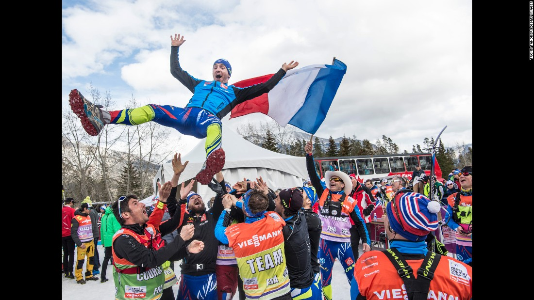 Maurice Manificat celebrates with the France team after Cross Country Men 15.0 km Pursuit Classic on Saturday, March 12, in Canmore, Alberta, Canada.
