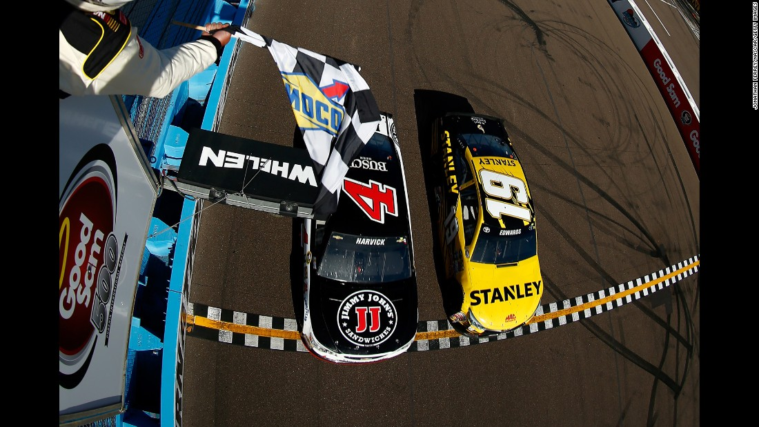Kevin Harvick, driver of car No. 4, beats Carl Edwards, driver of  No. 19, to the checkered flag to win the NASCAR Sprint Cup Series Good Sam 500 at Phoenix International Raceway in Avondale, Arizona, on Sunday, March 13. <br />