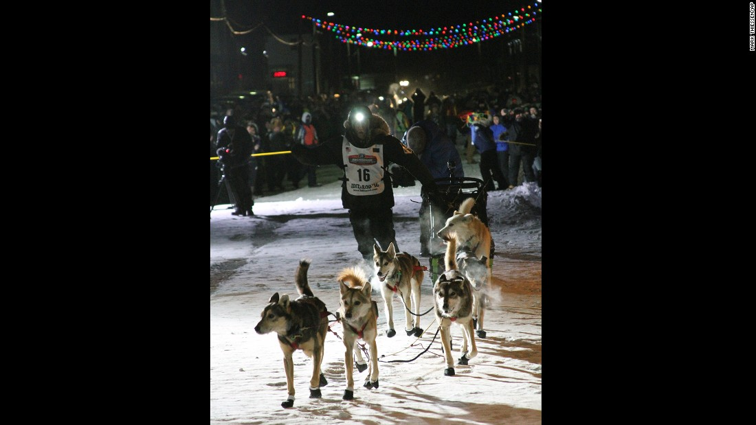 Dallas Seavey approaches the finish of the Iditarod Trail Sled Dog Race on Tuesday, March 15, in Nome, Alaska. Seavey won his third straight Iditarod, for his fourth overall title in the last five years.