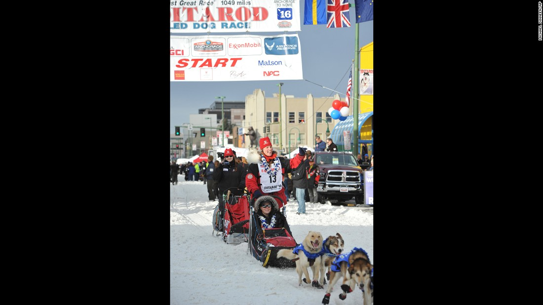 Race veteran Aliy Zirkle waves at the ceremonial start in Anchorage, Alaska.