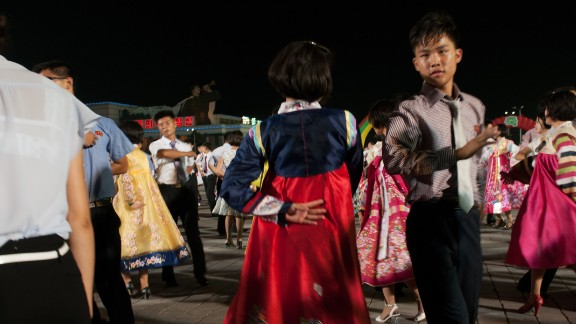 This scene was captured during a dance held to commemorate the 70th anniversary of Liberation from Japan at Pyongyang's Kim Il-sung Square.