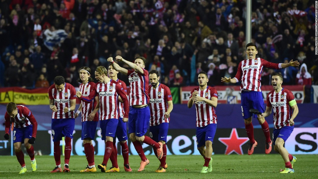 Atletico de Madrid players celebrate their passage after a remarkable shootout in which they scored all eight of their penalties.