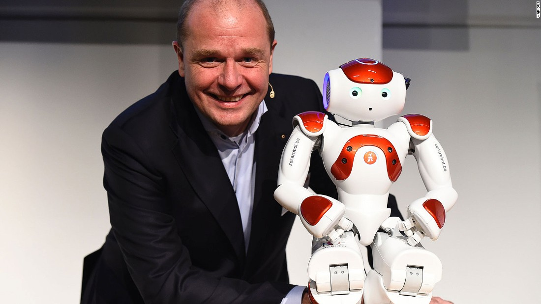 Pictured here with one of his developers, Fabrice Goffin of Belgium's Zora Robotics, Mario is a small robot who began life as a health worker but is now being used in hotels.