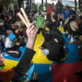 Dene Games athletes at the 2016 Arctic Winter Games take part in hand games