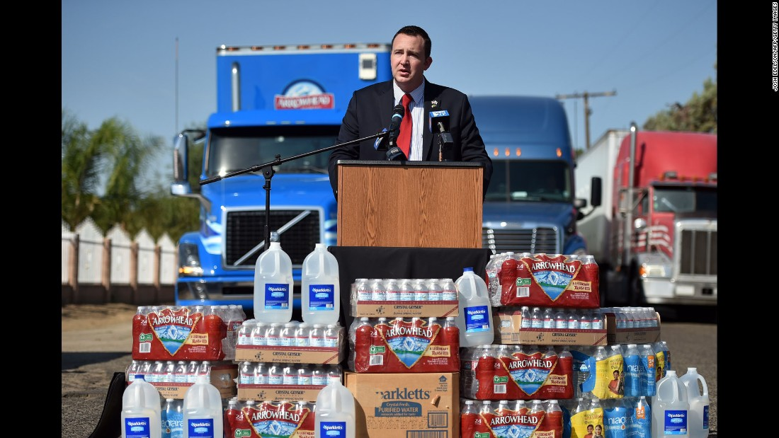 California State Assemblyman Devon Mathis speaks to members of the media after he helped secure a donation of 100,000 water bottles in September. More than 300 homes in Porterville, California, were out of running water because of dried-up wells.