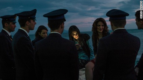 Cadets flirting at dusk, Naples, 2014.