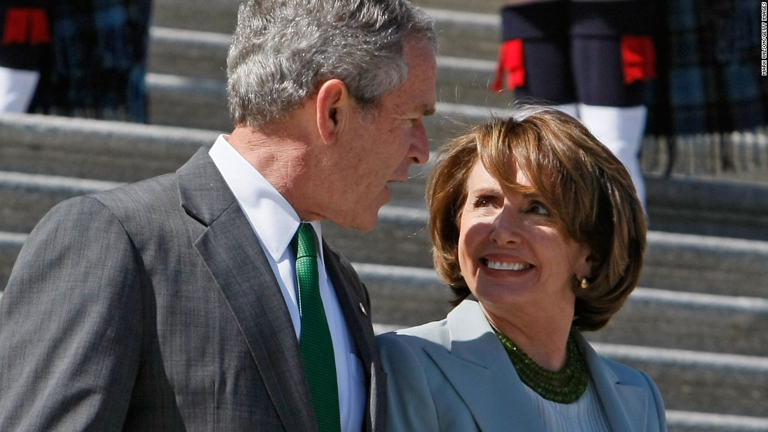 Bush walks down the Capitol steps with Pelosi after a luncheon for Irish Prime Minister Bertie Ahern at the U.S. Capitol on March 17, 2008.