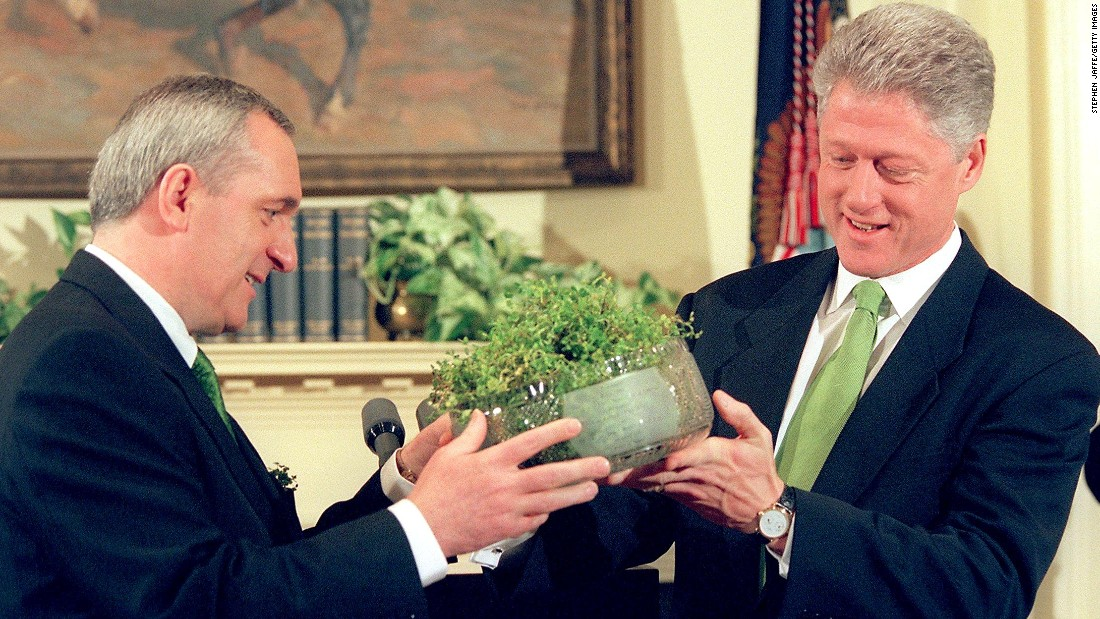 Former President Bill Clinton accepts a bowl of Shamrock, the traditional symbol of St. Patrick's Day, from Irish Prime Minister Bertie Ahern during ceremonies on March 17, 1998 at the White House.