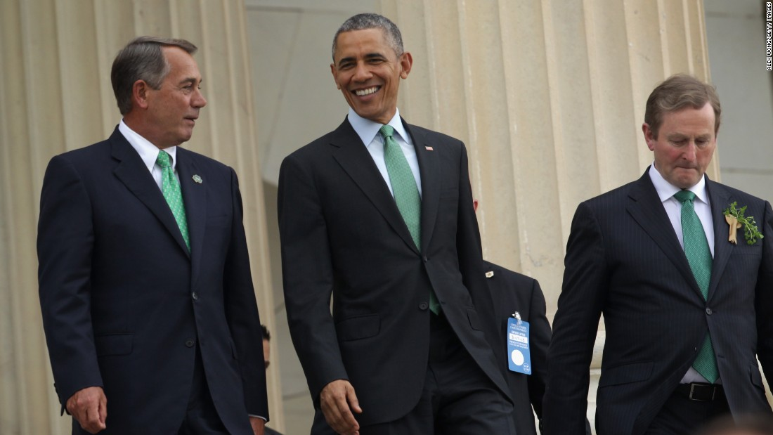 Then-Speaker of the House John Boehner, Obama and Irish Prime Minister Enda Kenny walk down the steps of the House of Representatives after attending the St. Patrick's Day luncheon at the U.S. Capitol on March 17, 2015.