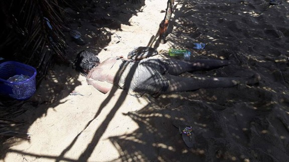 A photo taken by a witness to the attack shows a woman's body on the beach.
