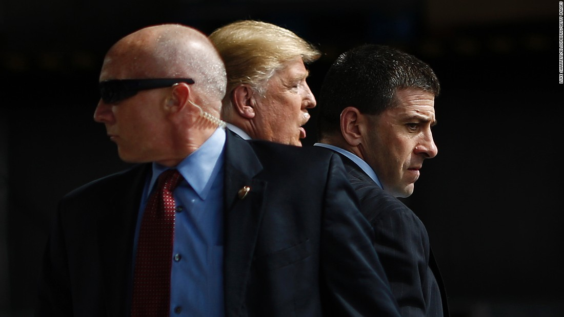 Secret Service agents surround Republican presidential candidate Donald Trump during a campaign event in Dayton, Ohio, on Saturday, March 12.