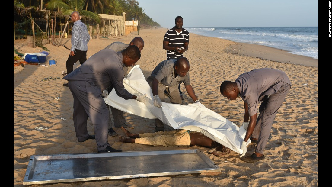 "People put a white sheet over a body after gunmen went on a shooting rampage in Grand-Bassam, Ivory Coast, on Sunday, March 13. An al Qaeda affiliate has claimed responsibility for <a href=""http://www.cnn.com/2016/03/14/africa/gallery/ivory-coast-attack/index.html"" target=""_blank"">the deadly attacks on three hotels.</a>"