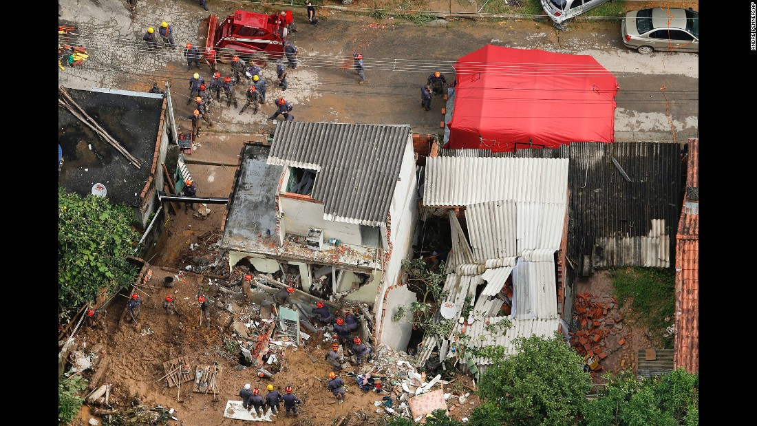 Rescue workers search for survivors Friday, March 11, after a mudslide in Mairipora, Brazil.
