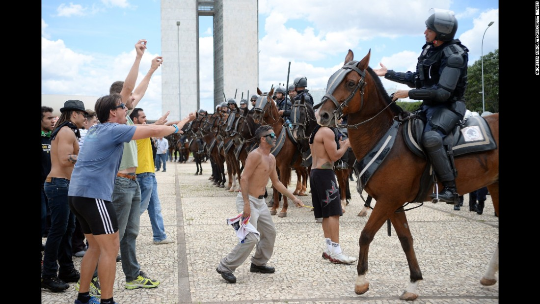 Protesters face off with police in Brasilia on March 17.
