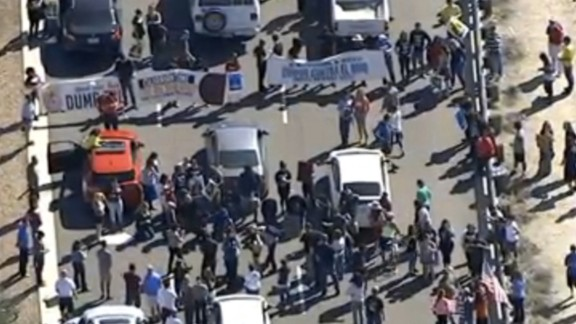 Protesters block the roadway near Donald Trump's rally on March 19, 2016 in Arizona.