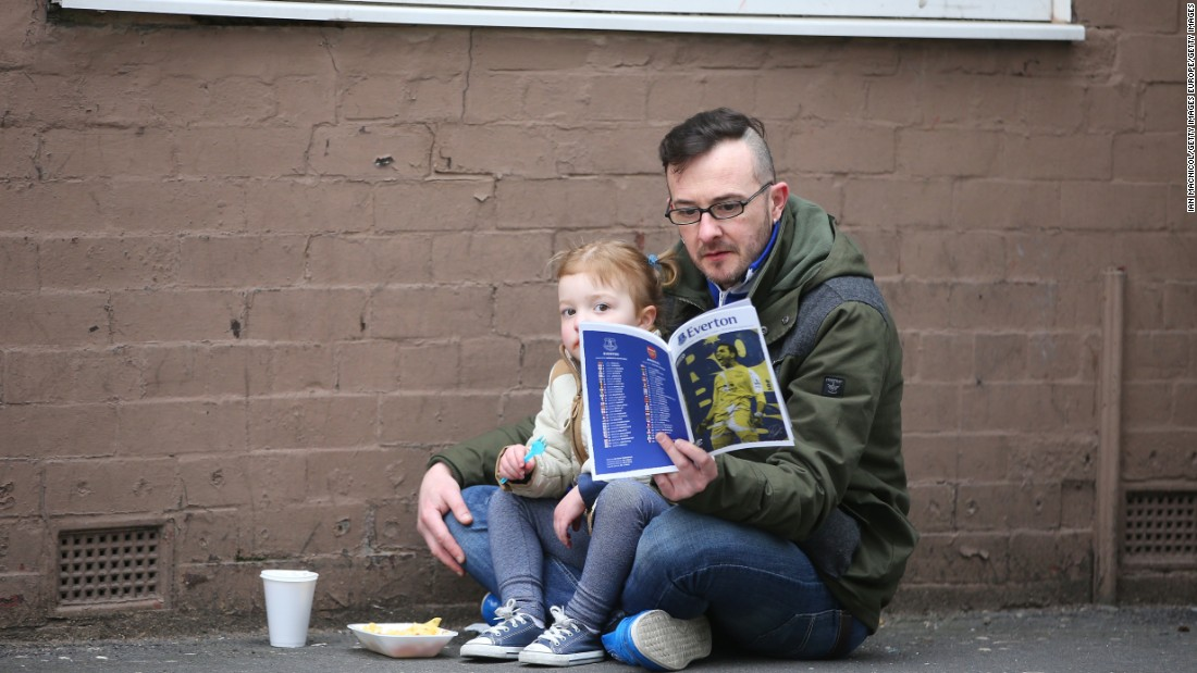 Everton fans, meanwhile, were more subdued. These two spent time reading the matchday program outside Goodison Park stadium prior to the Premier League match between Everton and Arsenal.