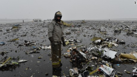 A Russian Emergencies Ministry employee surveys the flydubai wreckage Saturday.