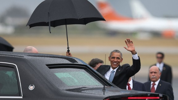Obama waves shortly after arriving at Jose Marti International Airport.