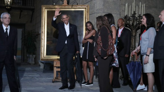 The first family stops to look at a painting of Abraham Lincoln in the Museum of the City of Havana on March 20.