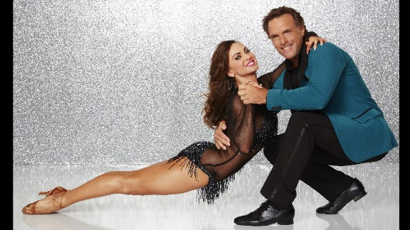 Heisman Trophy winner Doug Flutie, who was paired with Karina Smirnoff, played football professionally in the USFL, the National Football League and the Canadian Football League. He's now an analyst for the NBC Sports Group. The pair were eliminated in week 6.