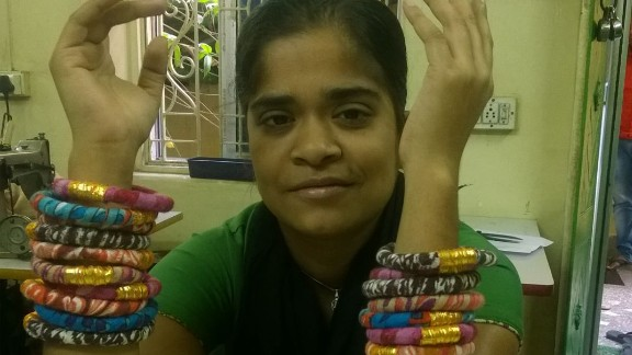 Ruby was once a student at Apne Aap and now she works with other women to make the bracelets sold by Rosena Sammi Jewelry. The money she earns supports her family.